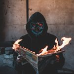 person-holding-a-burning-news-paper-close-up-photography-2538122